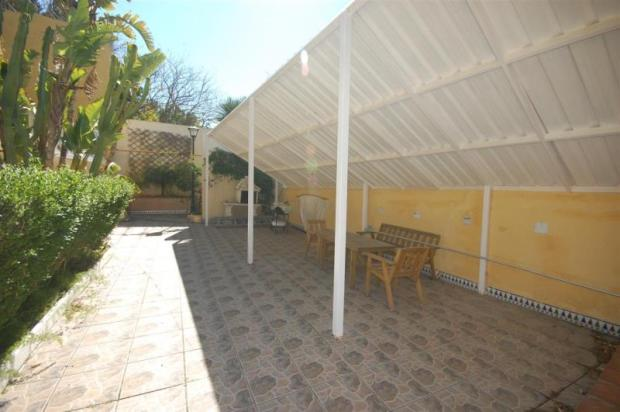 Large covered porch by pool with built in BBQ