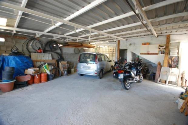 House has enormous garage & separate utility room