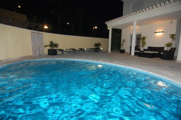 Enjoy a swim at night, pool has massage jets