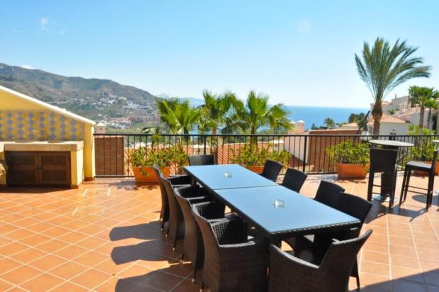 Outdoor entertainment area with bbq area nearby