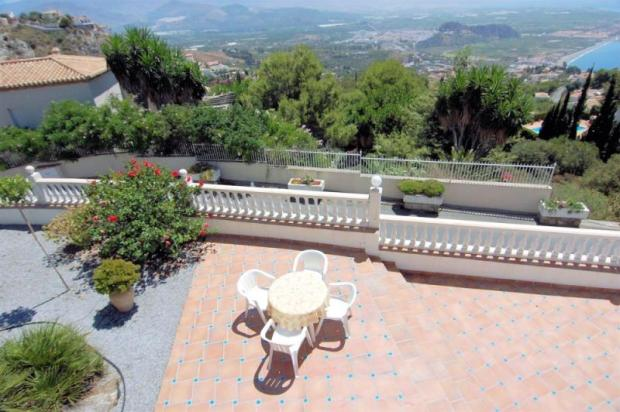 The pool terrace connects to the level, garden