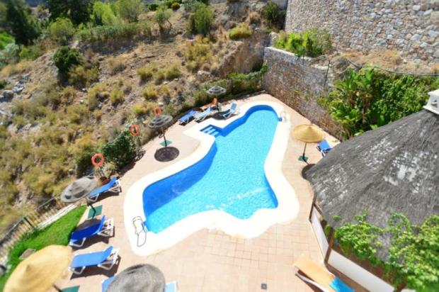 You can see the communal pool from the terrace