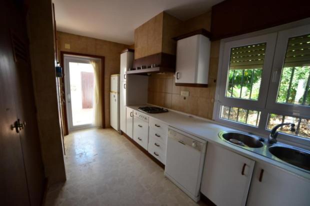 Kitchen opens onto patio / utility area