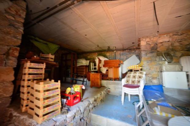 Storage area under house