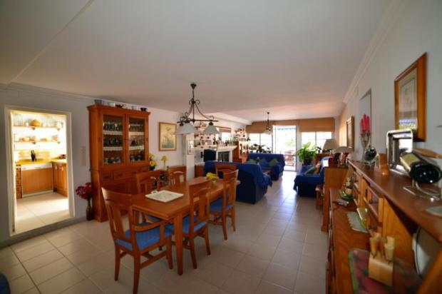 Kitchen is next to the lounge & on level of pool