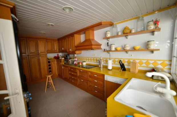 Large kitchen is on pool level & has views to pool