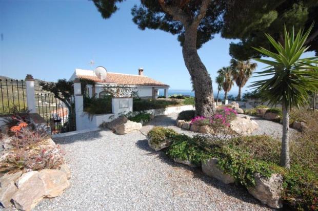Pretty entrance to villa with sea & mountain views