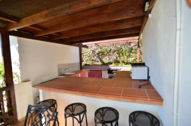 Outdoor kitchen next to the covered terrace