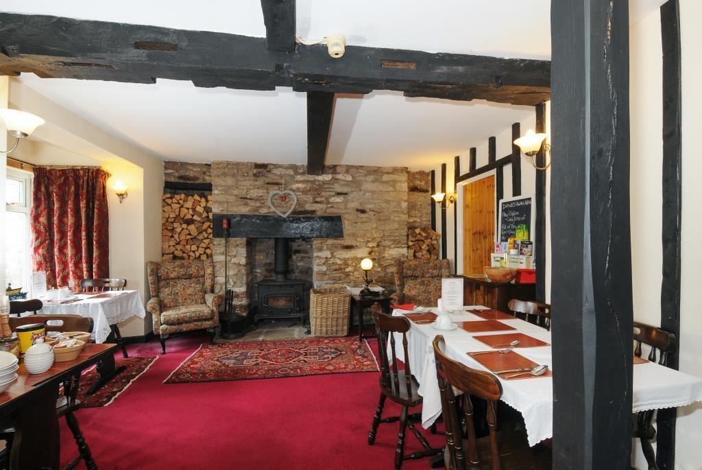Guest dining room with exposed beams