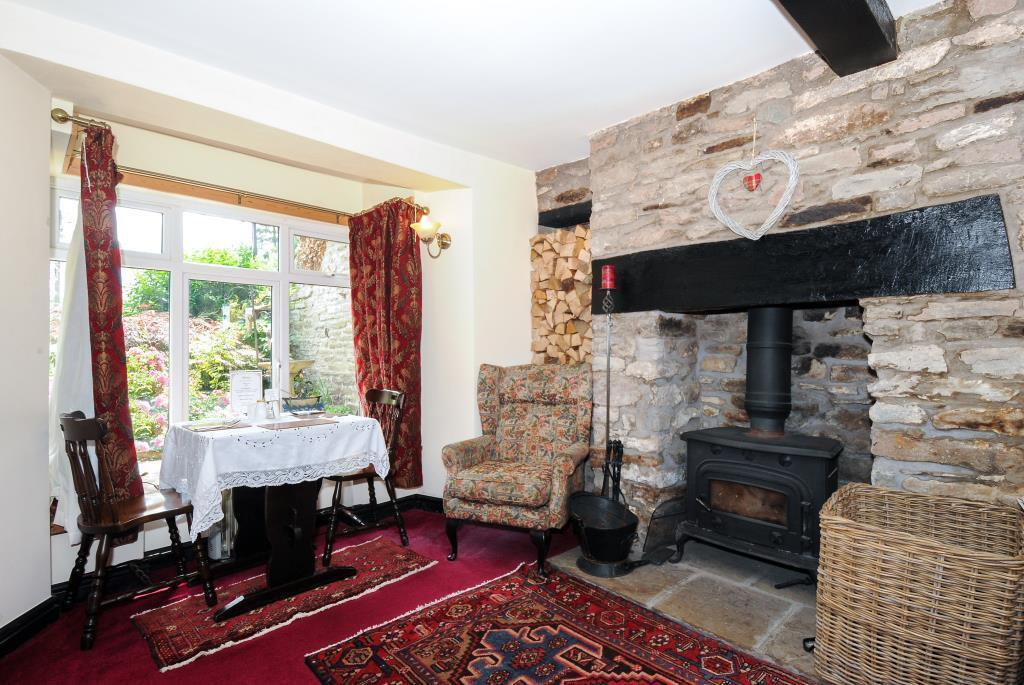 Traditional wood burner in lovely stone fireplace