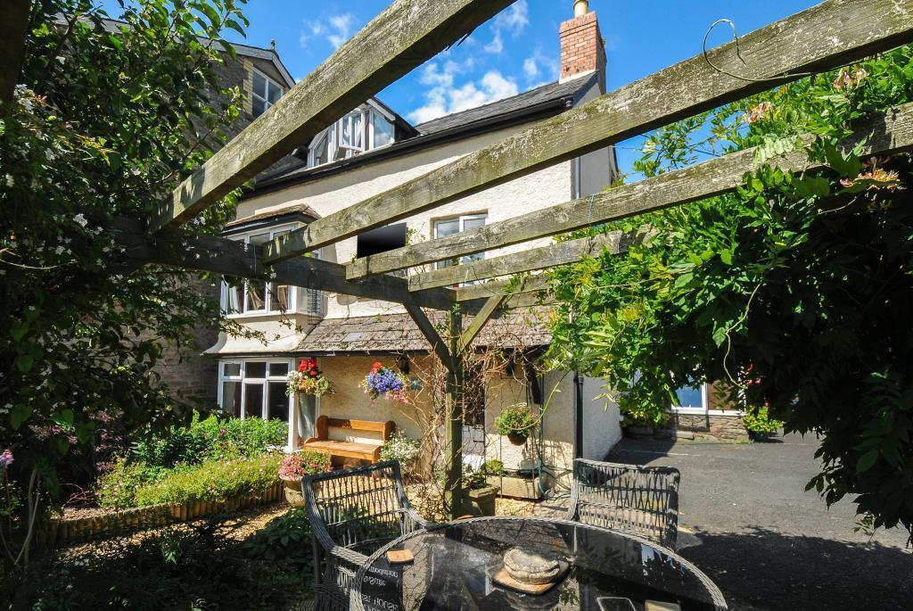 Sunny gardens with well established pergola