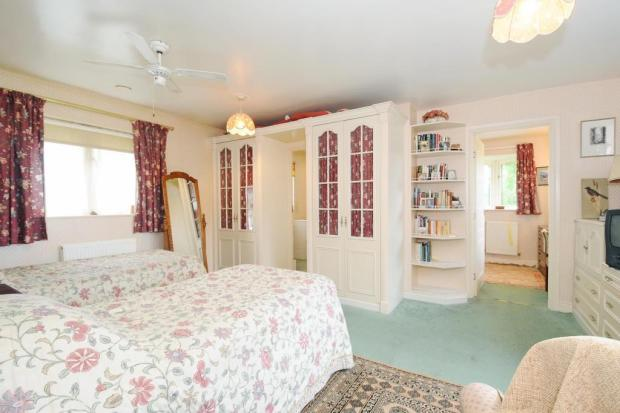 Master bedroom with dressing area and bathroom