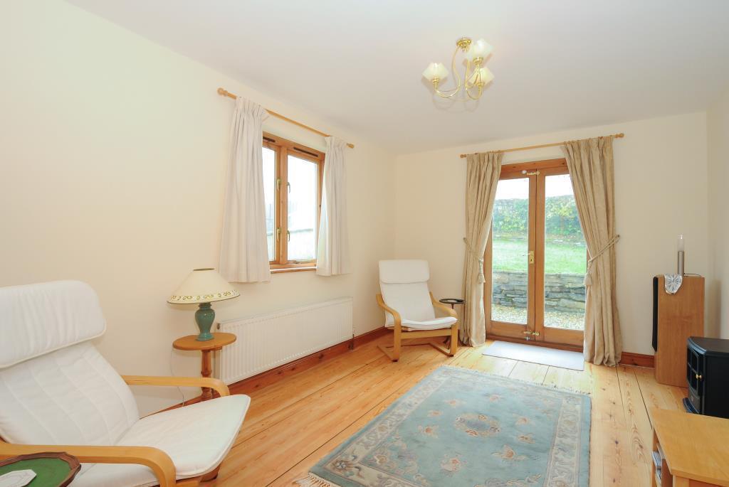 Living room with doors to the garden