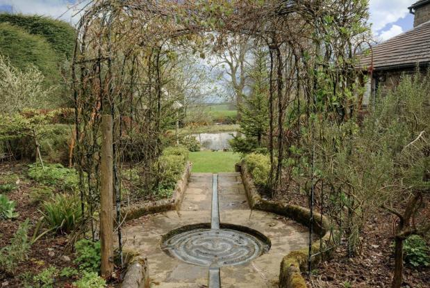 Mature gardens with many interesting features