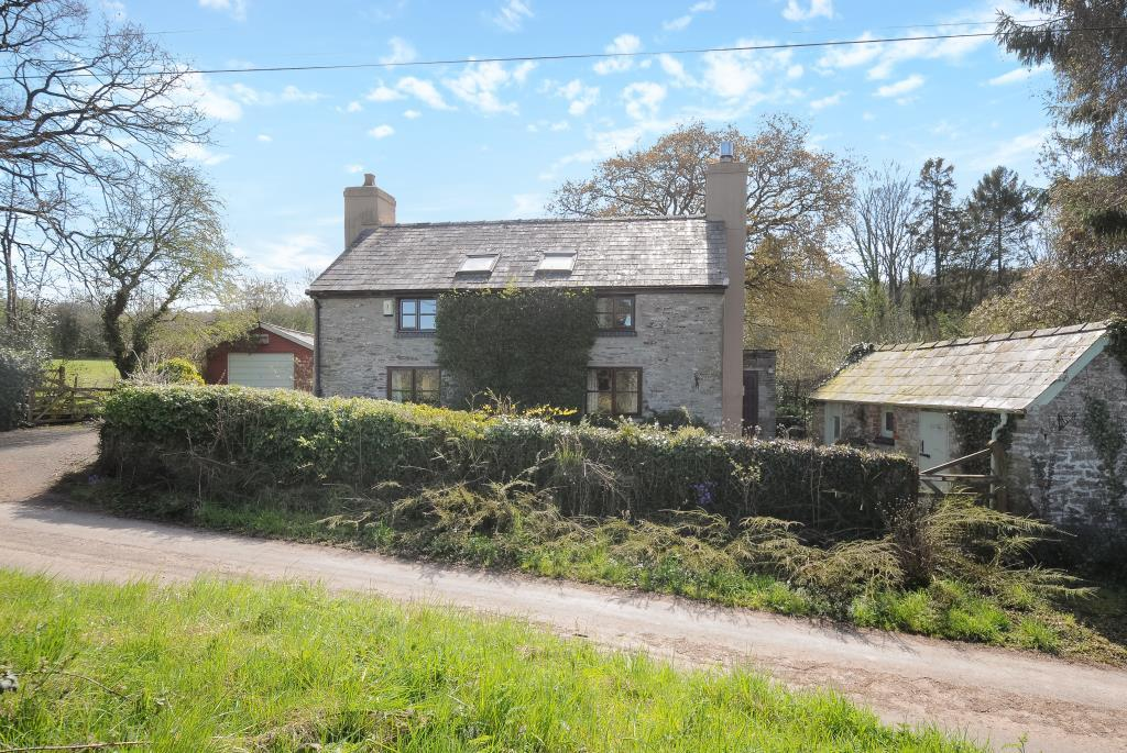 Village house with level paddocks and stabling