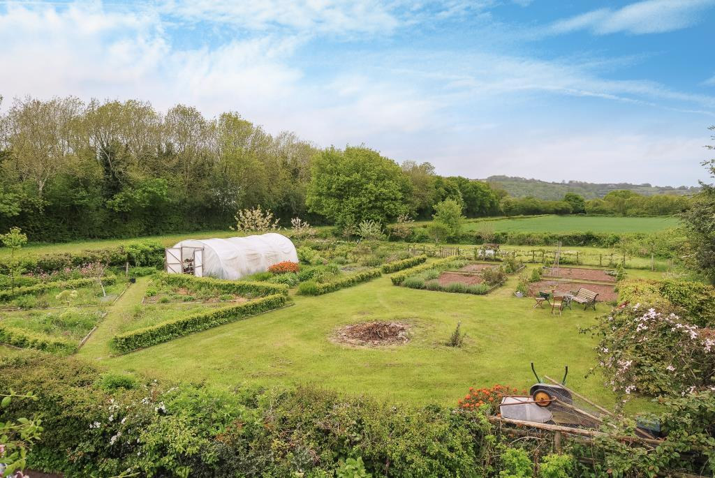 Views over kitchen garden to countryside