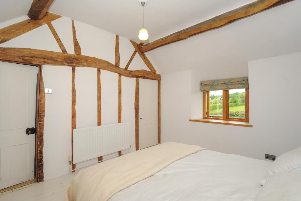 Bedroom with expoased beams