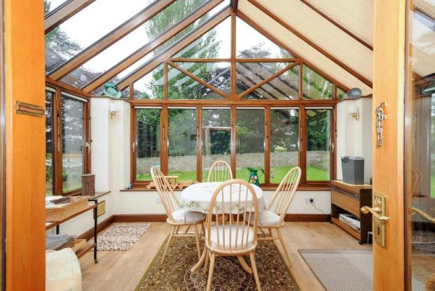 Excellent conservatory opening on to the garden