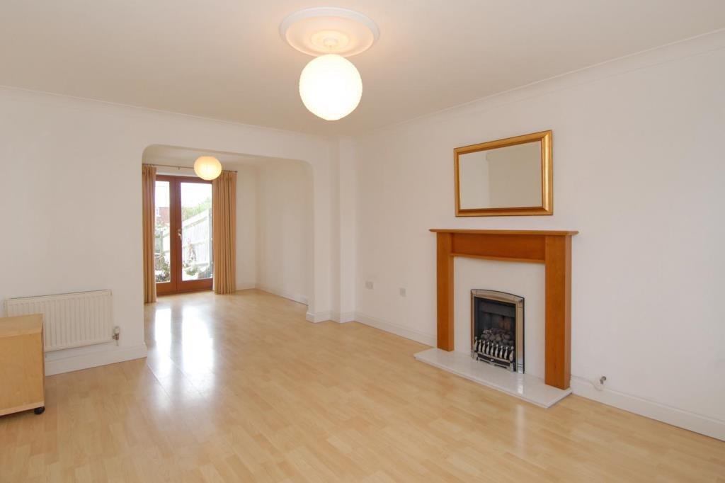 A lovely spacious through living room
