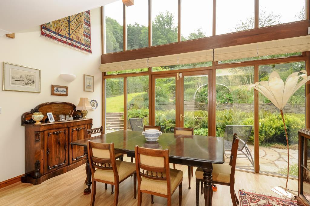 Dining room with full height glazing and gallery