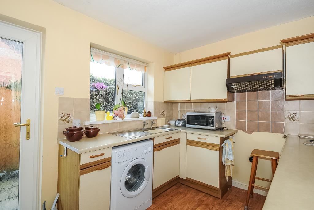 Kitchen with door to side