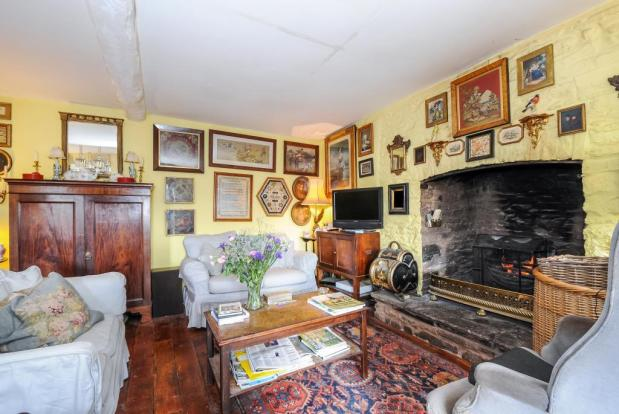 Traditional sitting room with Inglenook fireplace