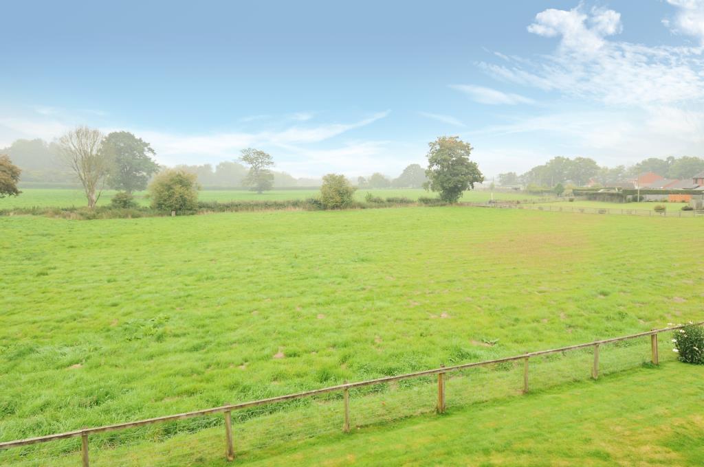 Farmland beyond the garden at the rear