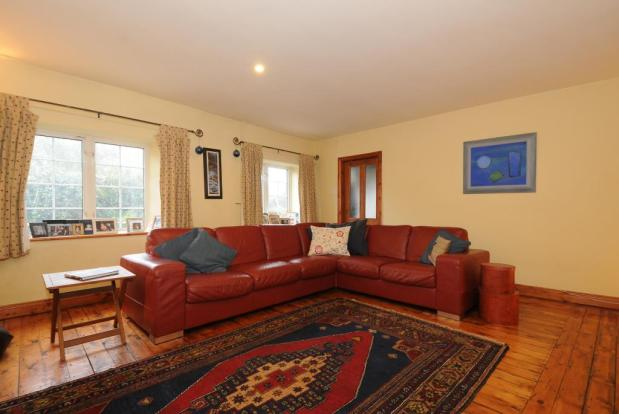 Lovely big sitting room with wood floor