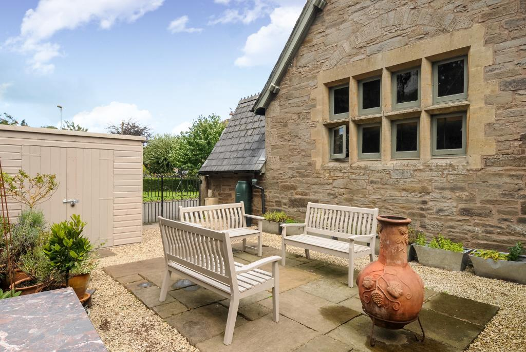 Sheltered rear terrace with sunny aspect