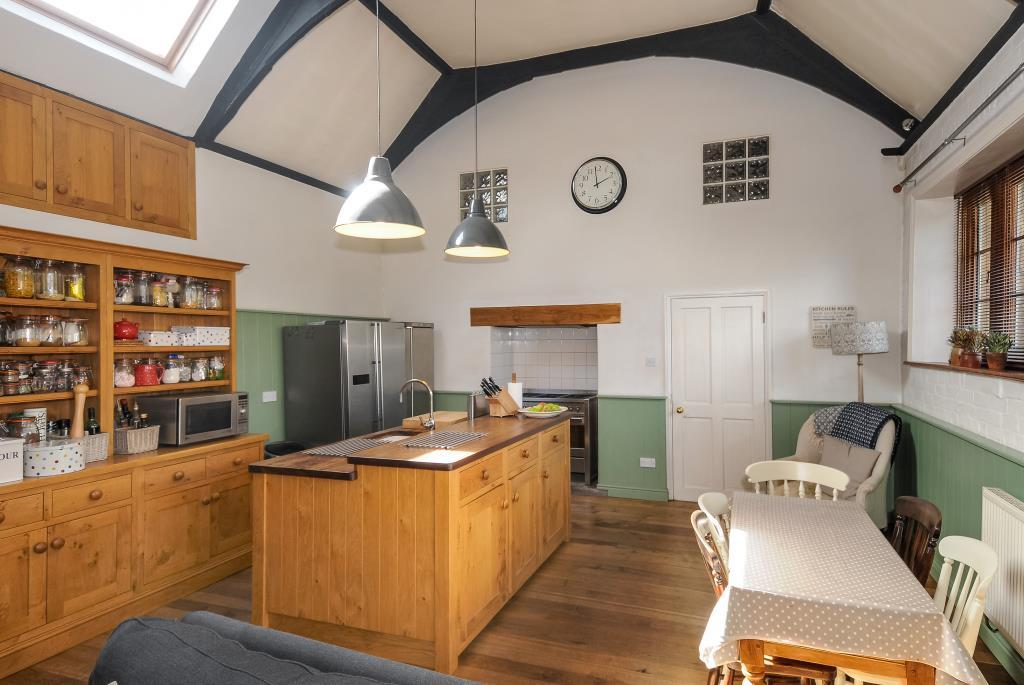 Character kitchen with adjoining dining area