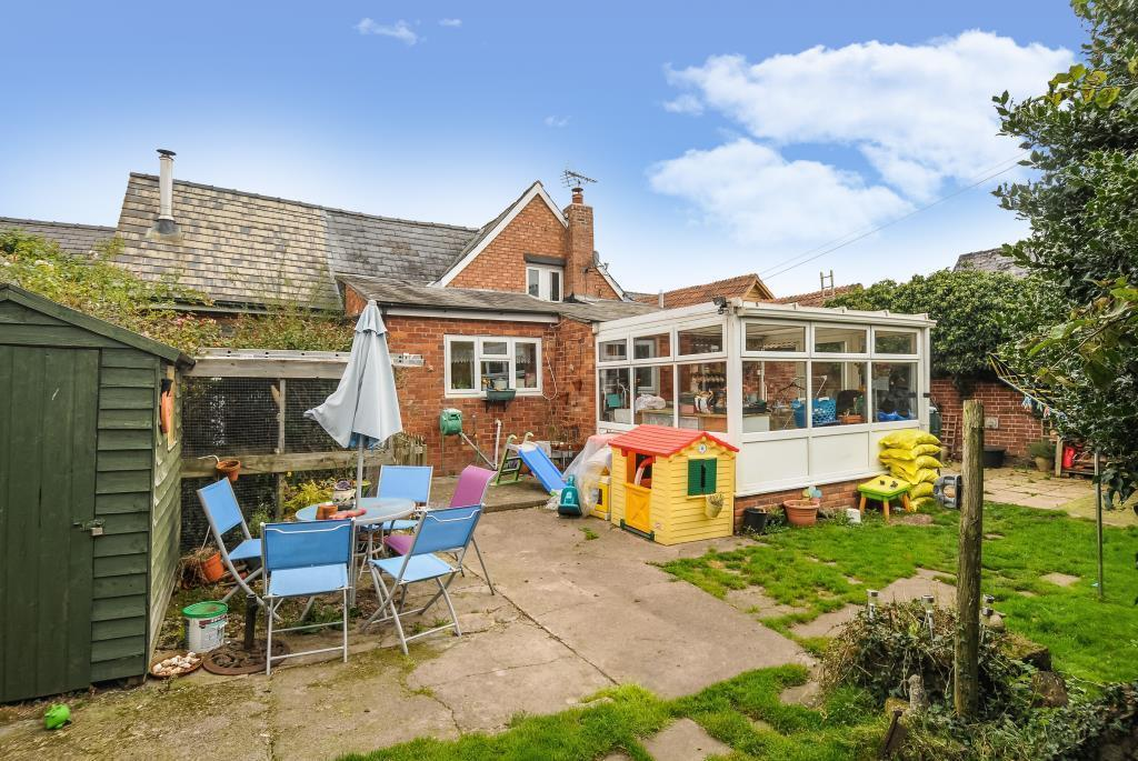 Rear terrace with conservatory/utility room