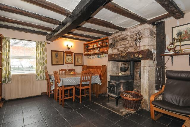 Dining area with beams and wood burning stove