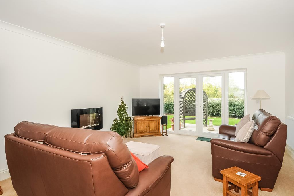 Spacious sitting room overlooking the garden