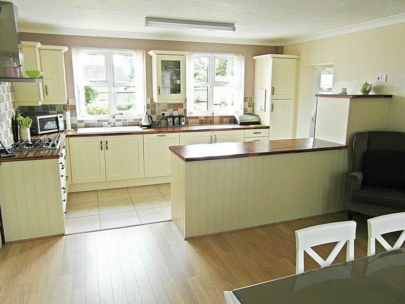 photo of cream olive white kitchen with floor tiles flooring tiled