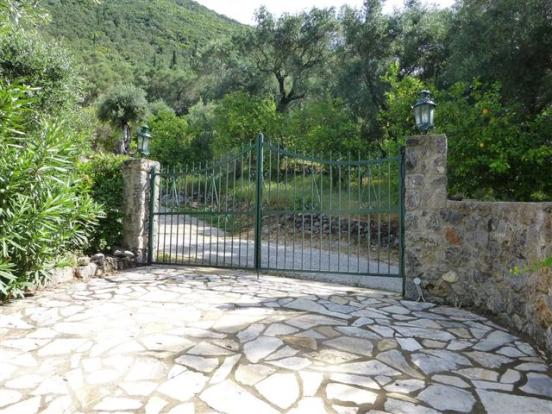 Gated parking area next to the villa