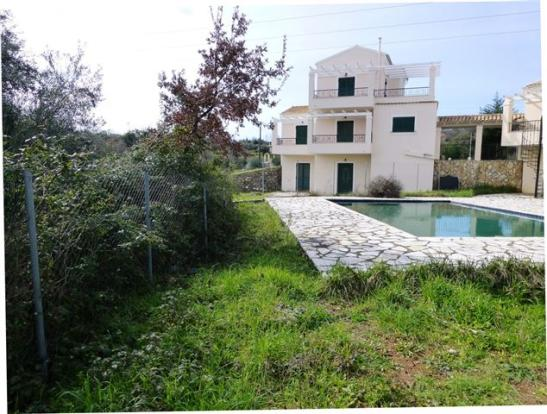 The house (with neighbouring pool)