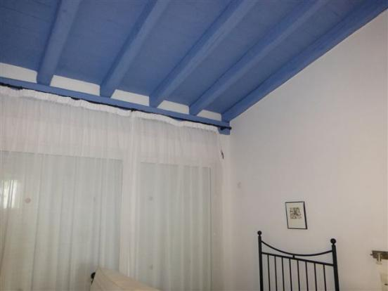 painted ceiling in one of the bedrooms