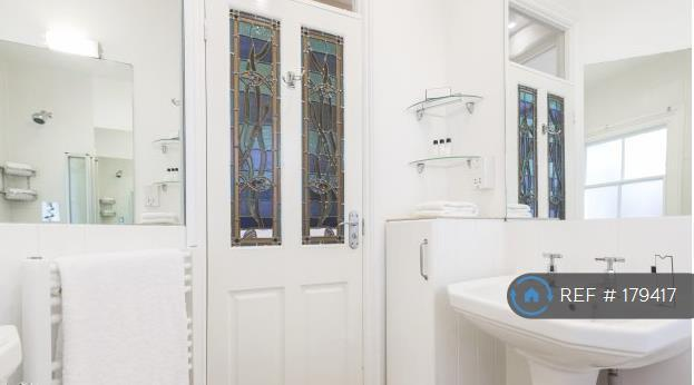 Bathroom With Bath And Good Mains Heated Shower