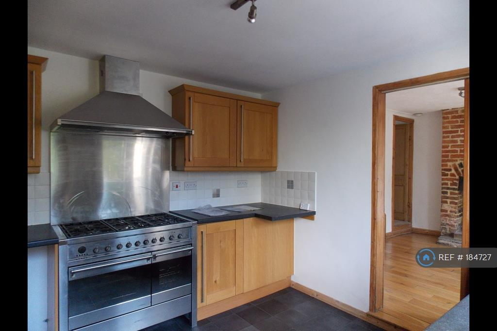 Kitchen With Smeg Cooker And Hood