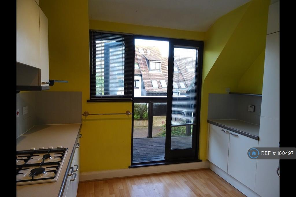 Kitchen With French Door To Balcony