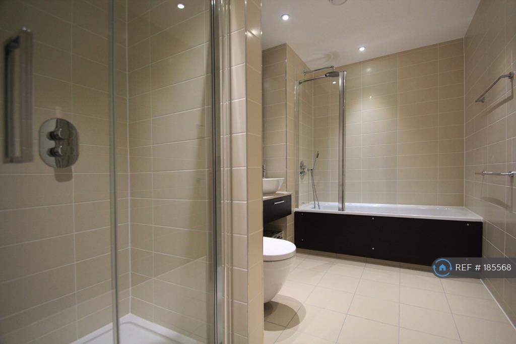 Bathroom With Separate Overhead Shower And Bath