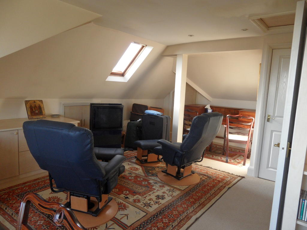 photo of beige brown loft conversion