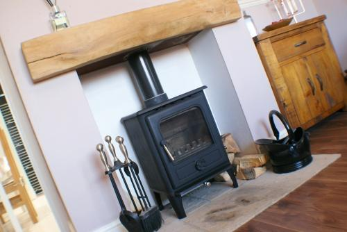 Solid Fuel Burner to Lounge