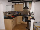 Open plan kitchen to living area with small space for bistro diner.