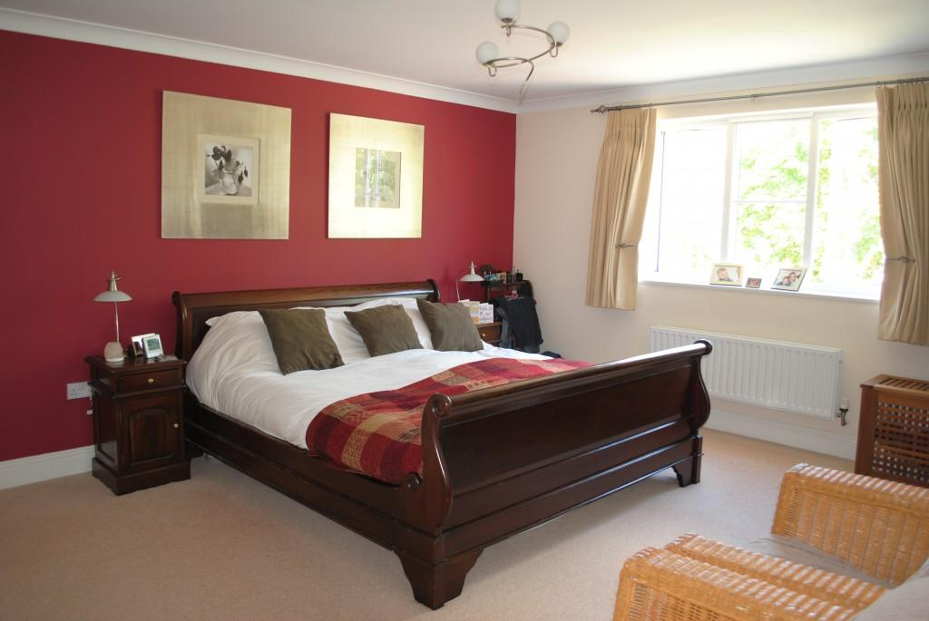 Red And Tan Master Bedroom