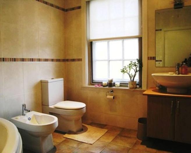 Dark beige brown design ideas photos inspiration for Orange and brown bathroom ideas