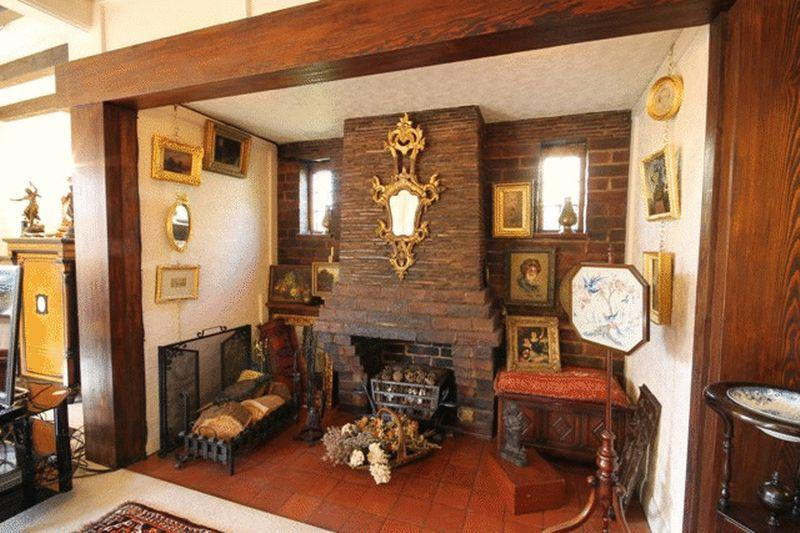 photo of chunky country house ornate brass with fireplace inglenook fireplace