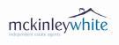 McKinley White, Exeter logo