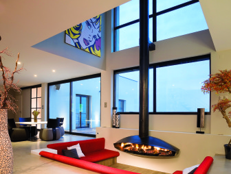 photo of contemporary double height open plan pop art red diligence international roy lichtenstein living room with nice flooring suspended fire artwork sculpture