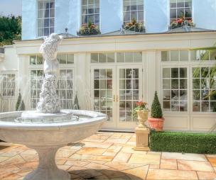 photo of blue breckenridge conservatory garden orangery and fountain patio terrace